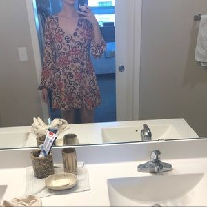 Summery low-cut dress with large slit in the back